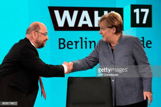 German Chancellor Angela Merkel head of the Christian Democratic Party CDU is greeted by her her challenger Martin Schulz head of the Social...