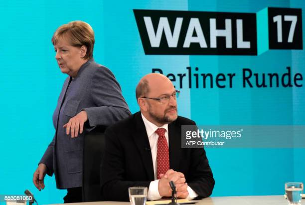 German Chancellor Angela Merkel head of the Christian Democratic Party CDU walks past her challenger Martin Schulz head of the Social Democratic...
