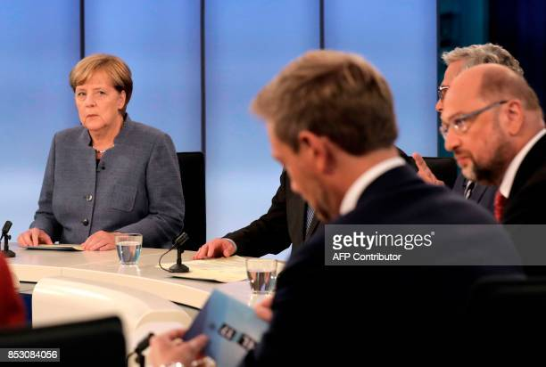 German Chancellor Angela Merkel head of the Christian Democratic Party CDU looks to her challenger Martin Schulz head of the Social Democratic Party...