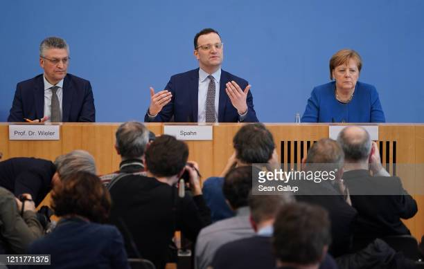 German Chancellor Angela Merkel Health Minister Jens Spahn and Robert Koch Institute President Lothar Wieler speak to the media over the ongoing...