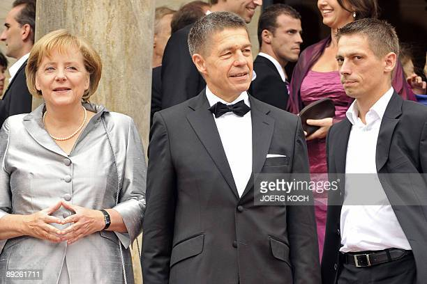 German Chancellor Angela Merkel her husband Joachim Sauer and his sohn Daniel arrive on the red carpet in front of the Festspielhaus in the southern...