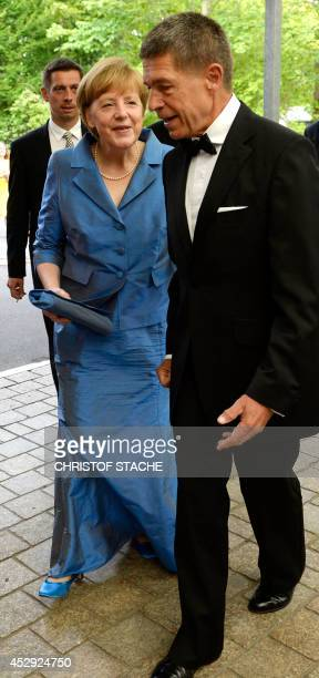 "German Chancellor Angela Merkel , her husband Joachim Sauer and his son Daniel Sauer arrive for the show ""Siegfried"" of the Bayreuth Wagner Opera..."
