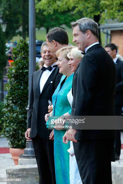 German chancellor Angela Merkel , her husband Joachim Sauer Dutch Prime Minister Mark Rutte , State Premier Markus Soeder and his wife Karin...
