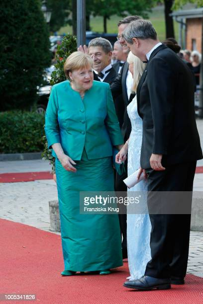 German Chancellor Angela Merkel, her husband Joachim Sauer, Dutch Prime Minister Mark Rutte, State Premier Markus Soeder and his wife Karin...