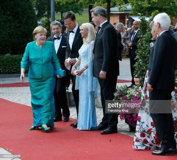 German Chancellor Angela Merkel, her husband Joachim Sauer, Dutch Prime Minister Mark Rutte, State Premier Markus Soeder , his wife Karin Baumueller...