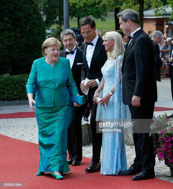 German Chancellor Angela Merkel her husband Joachim Sauer Dutch Prime Minister Mark Rutte State Premier Markus Soeder and his wife Karin Baumueller...