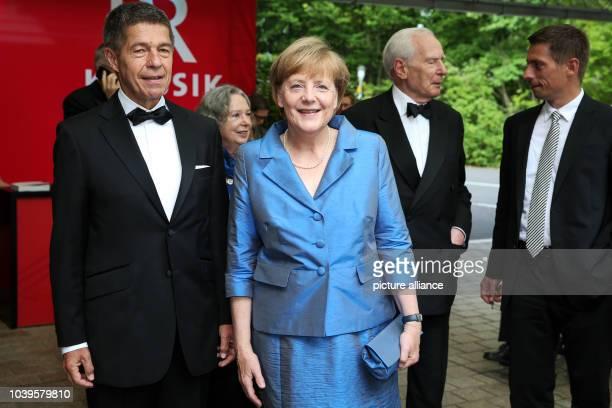 German Chancellor Angela Merkel her husband Joachim Sauer his son Daniel Sauer and Klaus von Dohnanyi former first mayor of Hamburg arrive for the...