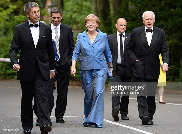 German Chancellor Angela Merkel , her husband Joachim Sauer , his son Daniel Sauer and former mayor of Hamburg, Klaus von Dohnanyi arrive for the...