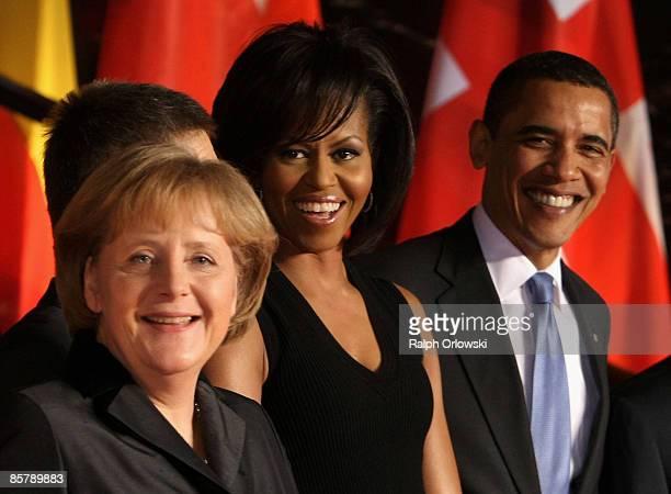 German Chancellor Angela Merkel her husband Joachim Sauer US President Barack Obama and his wife Michelle meet for a social program before a NATO...