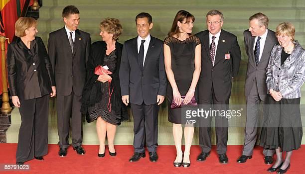 German Chancellor Angela Merkel her husband Joachim Sauer wife of Luxembourg Premier JeanClaude Juncker Christiane Frising French President Nicolas...