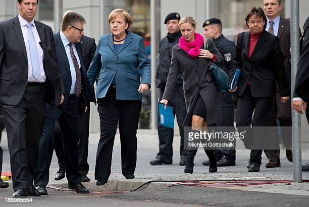 German Chancellor Angela Merkel her media councellor Eva Christiansen and her head of office Beate Baumann arrive for negotiations between the German...