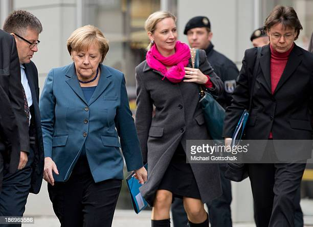 German Chancellor Angela Merkel her media councellor Eva Christiansen and her head of office Beate Baumann arrive for negotiations between the German...