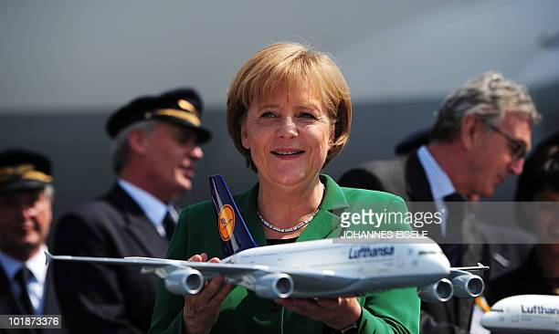 German Chancellor Angela Merkel holds a model of a Airbus A380 of Lufthansa at International Aerospace Exhibition on June 8 2010 at the Schoenefeld...