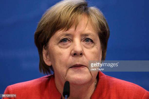 German Chancellor Angela Merkel holds a press conference on the final day of the European Council leaders' summit on June 29 2018 in Brussels Belgium...