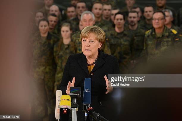 German Chancellor Angela Merkel holds a statement after visiting the 'Ostfriesland' rapidreaction medical unit of the Bundeswehr the German armed...