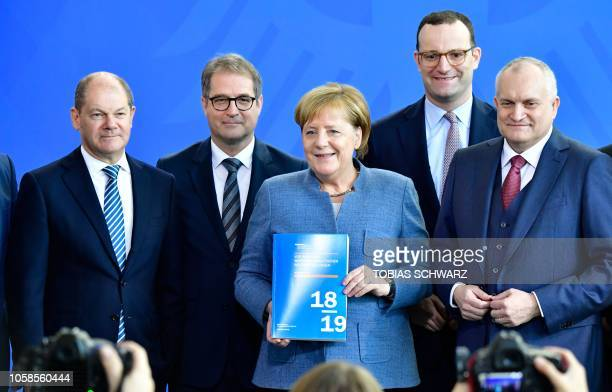 German Chancellor Angela Merkel holds the annual report of the German Council of Economic Experts on the country's economic development as German...