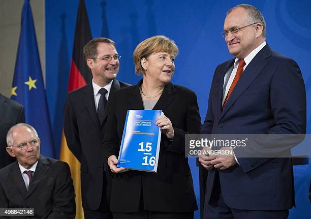 German Chancellor Angela Merkel holds the German Council of Economic Experts Annual Economic Report that was handed by GCEE chairman Christoph M...