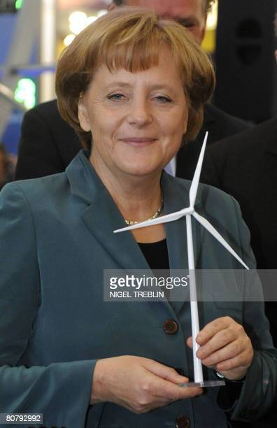 German Chancellor Angela Merkel holds the mockup of a wind turbine as she visits the Hannover Messe 2008 technology fair on April 21 2008 at the...