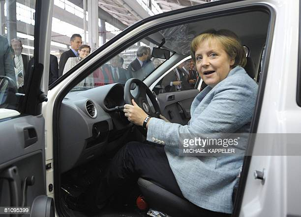 German Chancellor Angela Merkel inspects a Volkswagen car during a visit to the VW plant in Sao Bernardo do Campo southern Sao Paulo on May 15 2008...