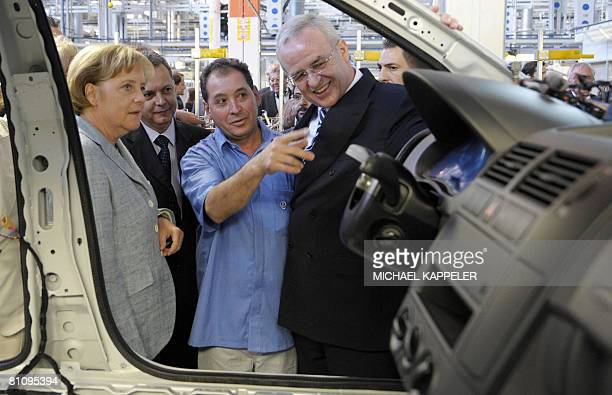 German Chancellor Angela Merkel inspects the production of a Volkswagen car with Volkswagen CEO Martin Winterkorn and a VW employee during a visit to...