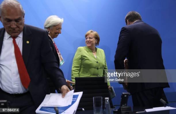 German Chancellor Angela Merkel International Monetary Fund head Christine Lagarde and Organization for Economic Cooperation and Development...