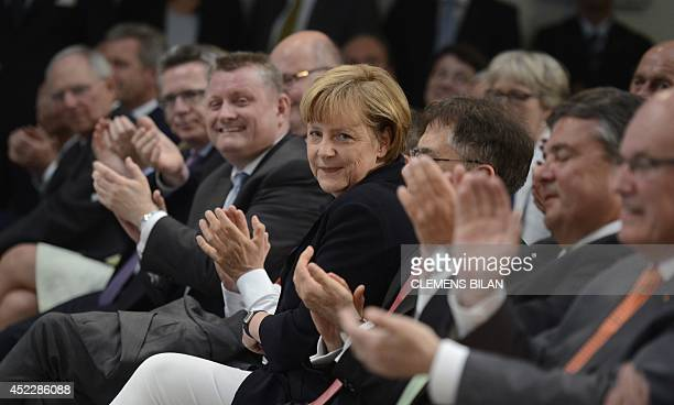 German Chancellor Angela Merkel is applauded by her guests during a festive event to celebrate Merkel's 60th anniversary of the German Chancellor on...