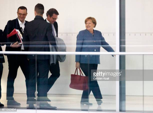 German Chancellor Angela Merkel is followed by CSU general secretary Andreas Scheuer and CDU politican Jens Spahn during the second phase of...