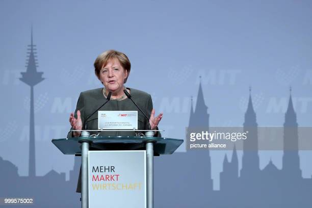 German Chancellor Angela Merkel is giving a speech at the small and mediumsized businesses coalition of CDU/CSUin Nuremberg Germany 01 September...