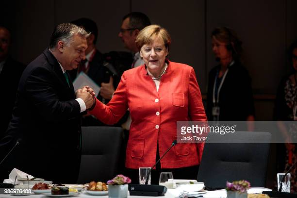 German Chancellor Angela Merkel is greeted by Hungarian Prime Minister Viktor Orban ahead of roundtable discussions on the final day of the European...