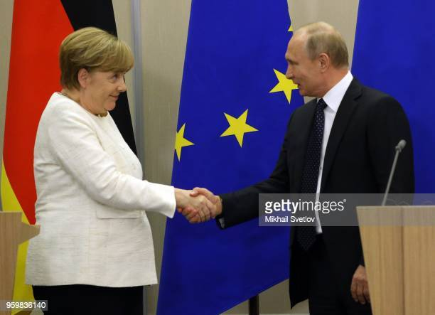 German Chancellor, Angela Merkel is greeted by Russian President, Vladimir Putin during a joint press conference at the Bocharov Ruchey State...
