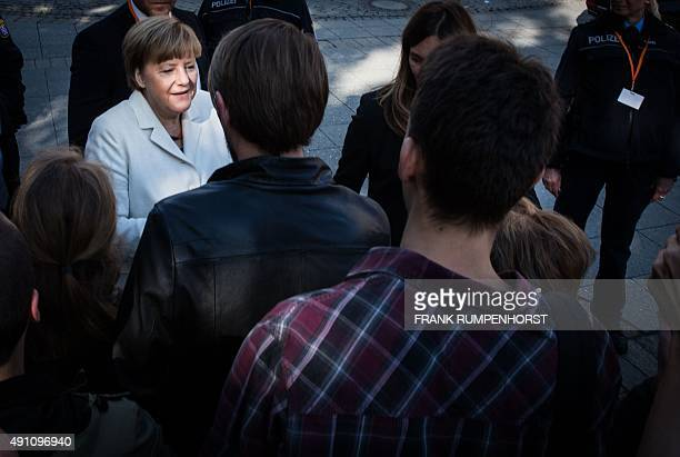 German Chancellor Angela Merkel is photographed arrives at a ceremony in the 'Alte Oper' in Frankfurt / Main Germany on October 3 2015 Germany on...