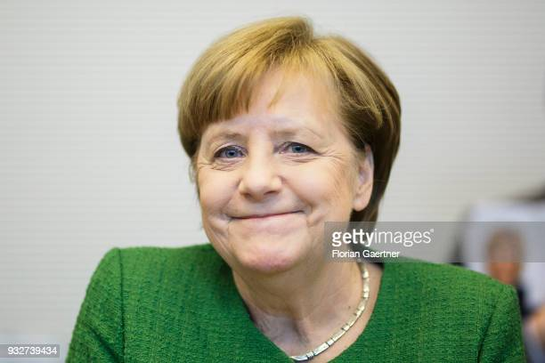 German Chancellor Angela Merkel is pictured before the faction meeting on March 13 2018 in Berlin Germany
