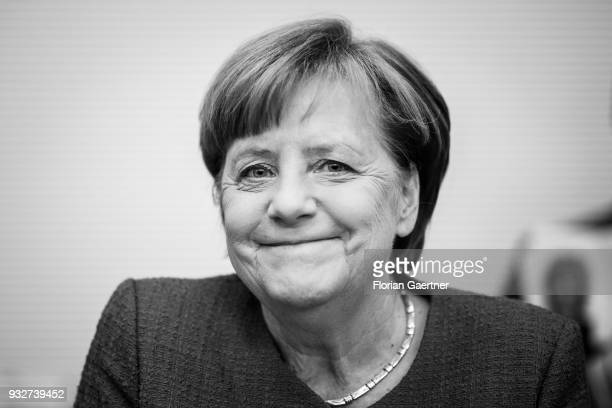 Image has been converted to black and white BERLIN GERMANY MARCH 13 German Chancellor Angela Merkel is pictured before the faction meeting on March...