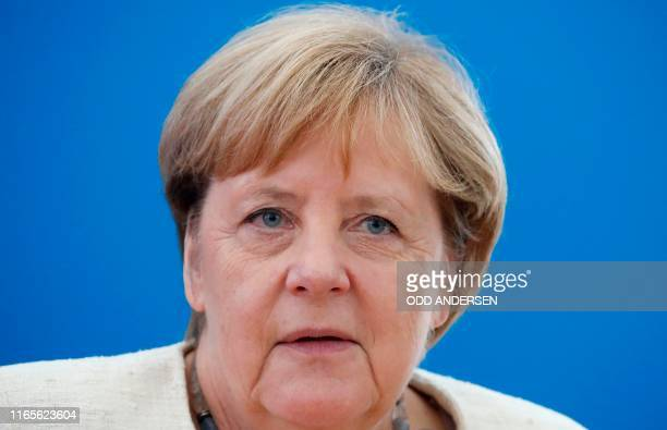 German Chancellor Angela Merkel is pictured during a leadership meeting at the CDU headquarters in Berlin on September 2 one day after regional...