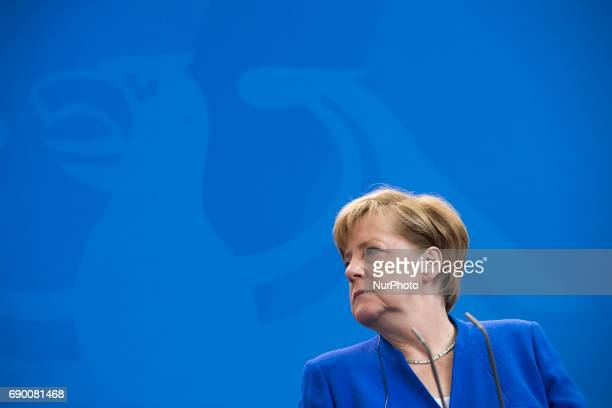 German Chancellor Angela Merkel is pictured during a news conference held with Indian Prime Minister Nerendra Modi following a signing ceremony of...