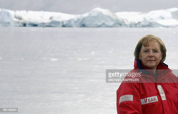 German Chancellor Angela Merkel is pictured onboard a boat navigating through a fjord near Ilulissat in Greenland 16 August 2007 Merkel and German...