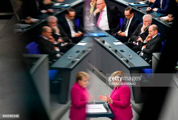 German Chancellor Angela Merkel is reflected as German Finance Minister and ViceChancellor Olaf Scholz Interior Minister Horst Seehofer Foreign...
