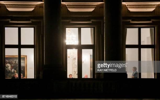 German Chancellor Angela Merkel is seen behind a window of the Deutsche Parlamentarische Gesellschaft in Berlin on November 15 as further exploratory...