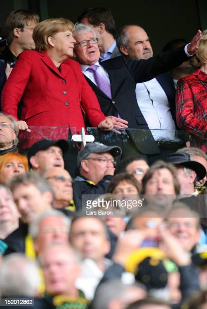 German Chancellor Angela Merkel is seen next to Reinhard Rauball, president of Deutsche Fussball Liga DFL and Borussia Dortmund, during the...
