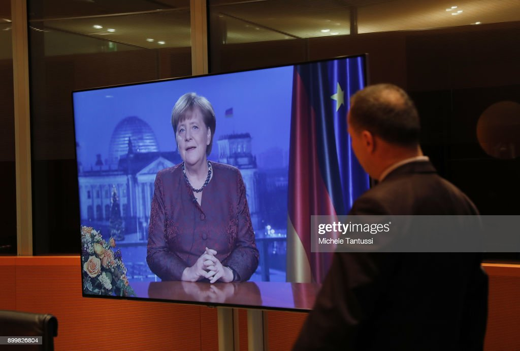 . German Chancellor, Angela Merkel is seen on a TV screen as she records her annual, televised new year's address on December 20, 2017 in Berlin, Germany. Merkel is entering 2018 still seeking a new government following elections in September, 2017. Her party, the German Christian Democrats (CDU), together with the CSU of Bavaria, are in talks with the German Social Democrats (SPD), though the outcome remains so far uncertain.