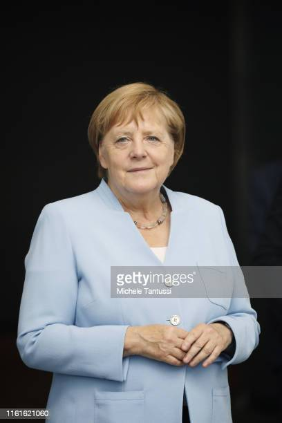 German Chancellor Angela Merkel is seen through a glass window as she awaits the arrival of Lithuanian President Gitanas Nauseda at the Chancellery...
