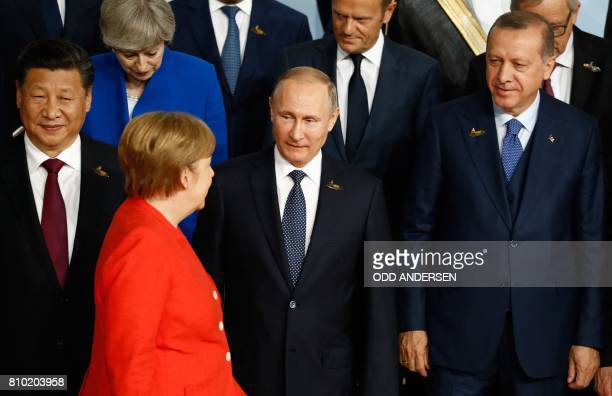 German Chancellor Angela Merkel is watched by China's President Xi Jinping Russia's President Vladimir Putin and Turkey's President Recep Tayyip...