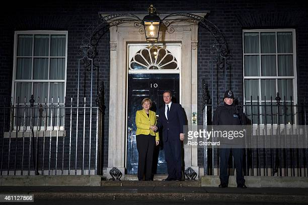 German Chancellor Angela Merkel is welcomed by Britain's Prime Minister David Cameron to 10 Downing Street on January 7 2015 in London England The...