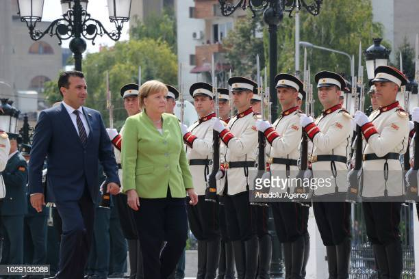 German Chancellor Angela Merkel is welcomed by Macedonian Prime Minister Zoran Zaev in Skopje Macedonia on September 8 2018