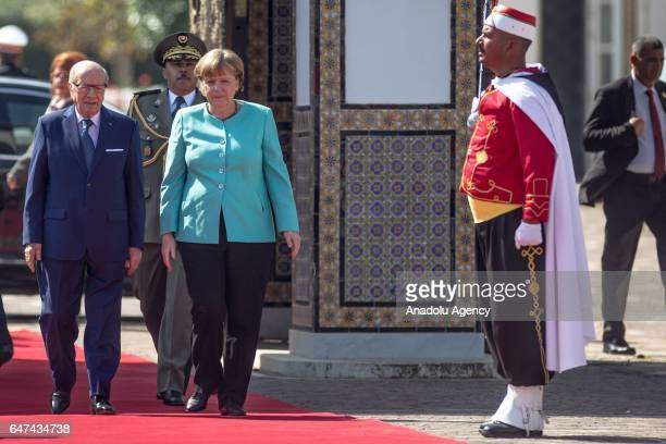 German Chancellor Angela Merkel is welcomed by Tunisian President Beji Caid Essebsi with an official ceremony at Kartaca Presidency Palace in Tunis,...