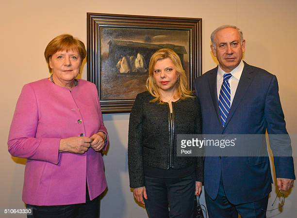 German Chancellor Angela Merkel Israeli Prime Minister Benjamin Netanyahu and his wife Sara Netanyahu visit the exhibition 'Art from the Holocaust...