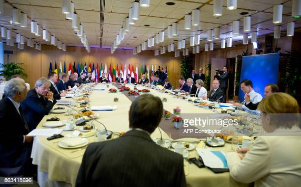 TOPSHOT German Chancellor Angela Merkel joins other EU leaders for a breakfast meeting during an EU summit in Brussels on October 20 2017 The EU is...