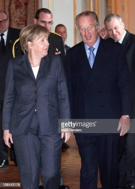 German Chancellor Angela Merkel, King Albert II of Belgium and Belgian Prime Minister Yves Leterme pose for a photo at Laeken Castle on November 2,...