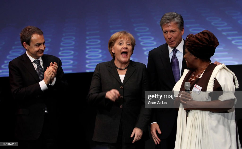 German Chancellor Angela Merkel (C) laughs as Spanish Prime Minister Jose Luis Rodriguez Zapatero (L), Bill McDermott, chairman of the German software giant SAP, and Christina Leranyane of the Kgautswane Community Development Center smile at the opening ceremony of the CeBIT Technology Fair on March 1, 2010 in Hannover, Germany. CeBIT will be open to the public from March 2 through March 6.