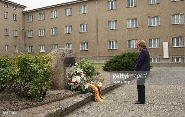 German Chancellor Angela Merkel lays a wreath while touring the former prison of the East German communistera secret police known as the Stasi at...
